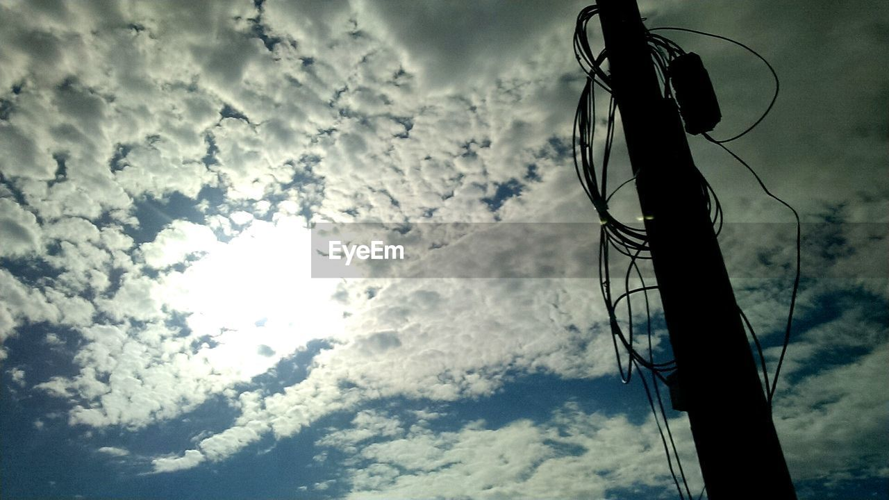 cable, cloud - sky, low angle view, connection, sky, technology, power line, power supply, no people, electricity, fuel and power generation, outdoors, day, nature, telephone line