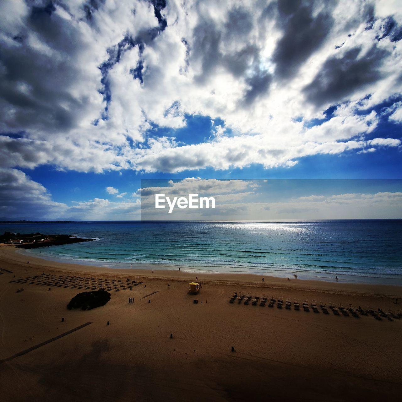 sea, beach, water, sky, land, cloud - sky, horizon over water, horizon, sand, beauty in nature, scenics - nature, tranquil scene, nature, tranquility, day, idyllic, non-urban scene, holiday, trip, outdoors