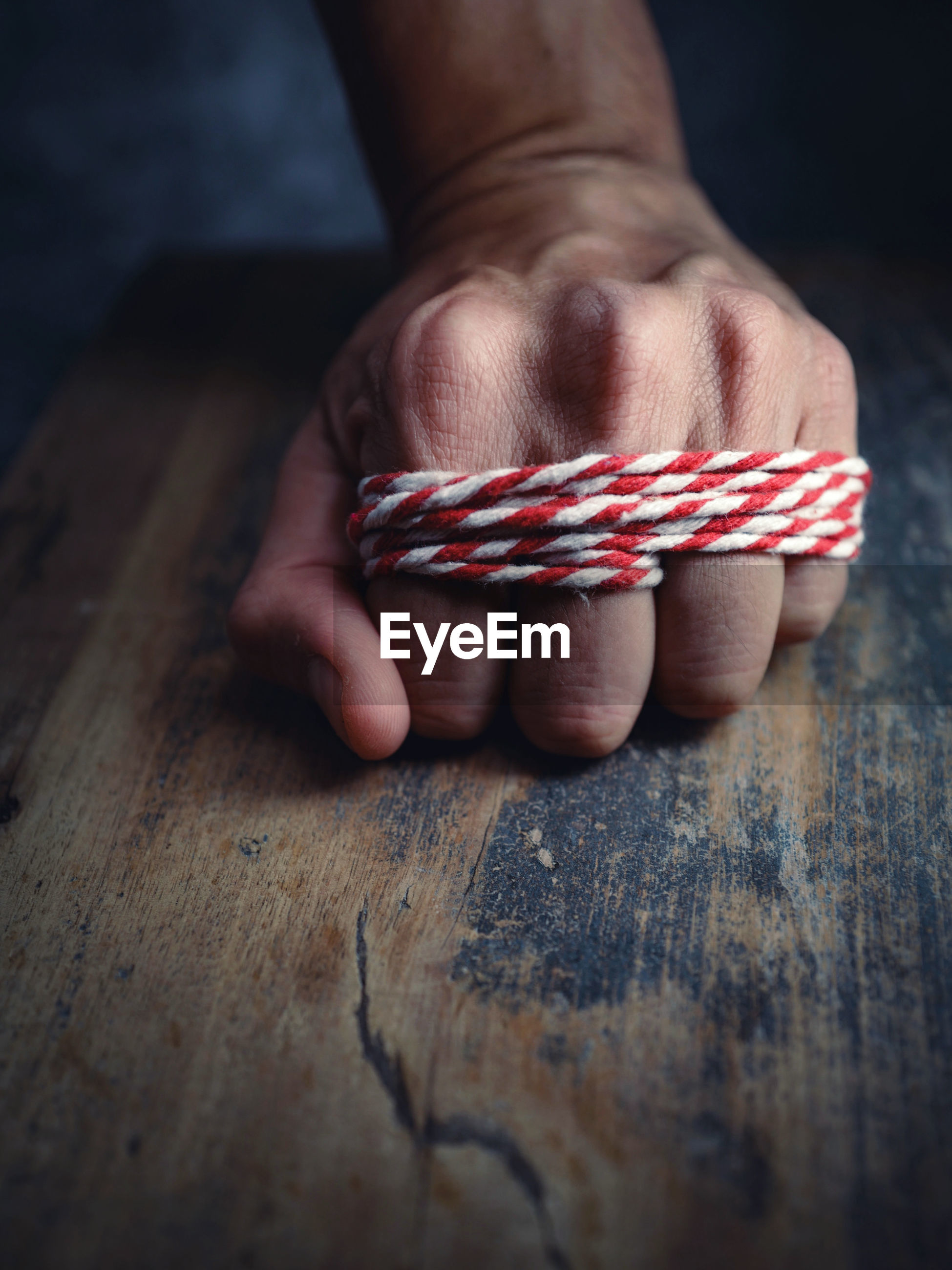 Tied fist on wood board