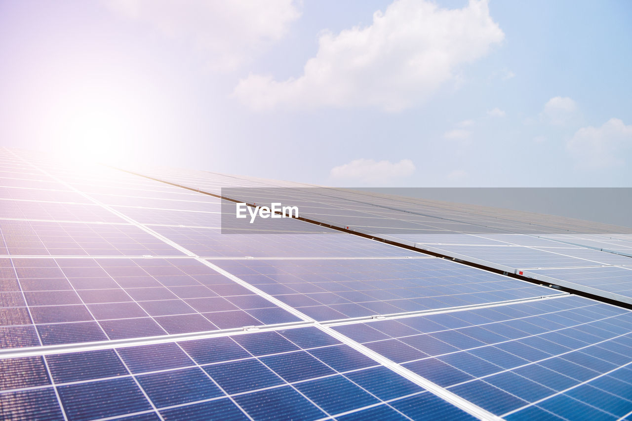 sky, renewable energy, solar panel, solar energy, alternative energy, fuel and power generation, environmental conservation, technology, environment, cloud - sky, nature, sunlight, day, no people, solar equipment, solar power station, low angle view, outdoors, power supply, blue, sustainable resources