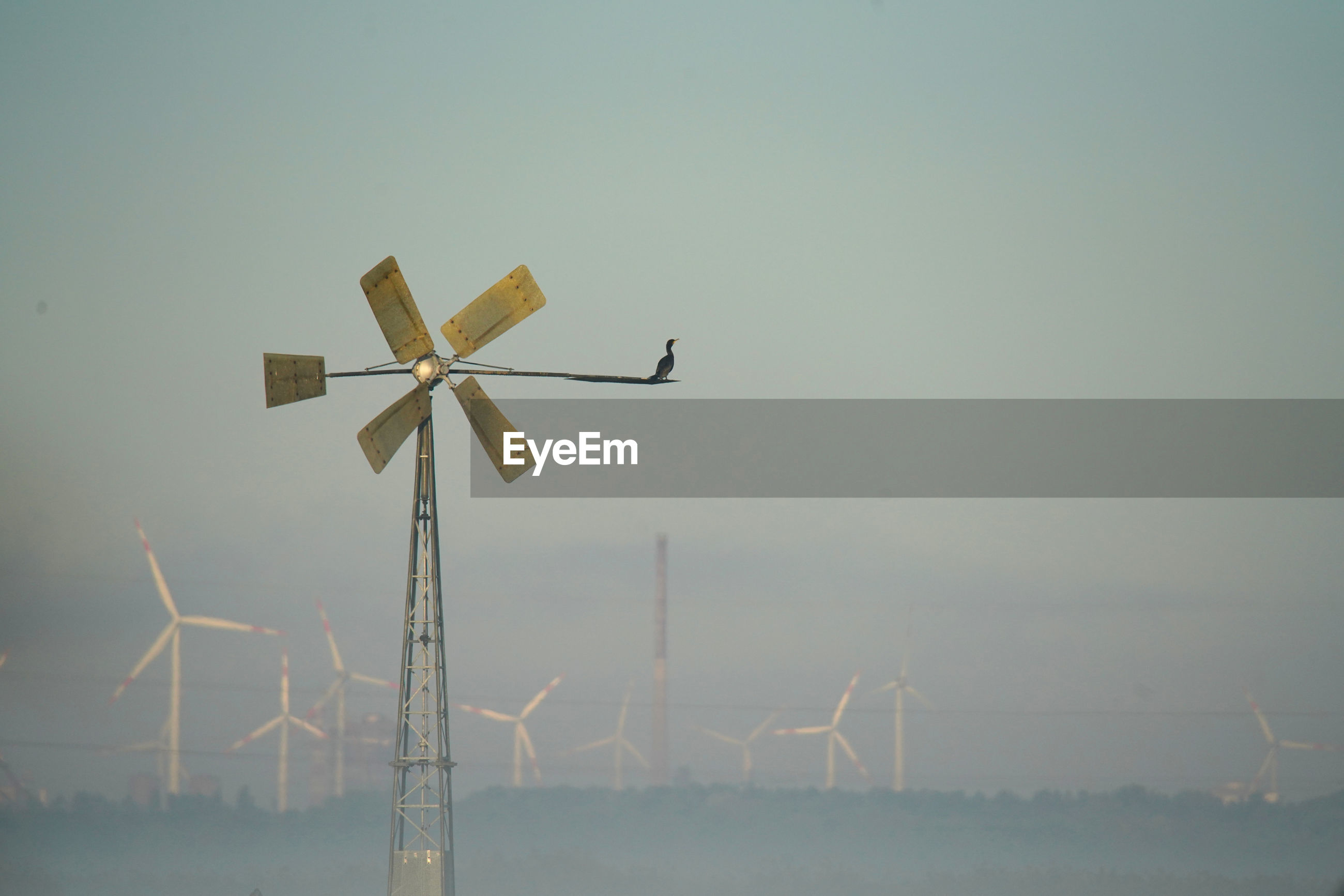 LOW ANGLE VIEW OF WIND TURBINES ON LANDSCAPE