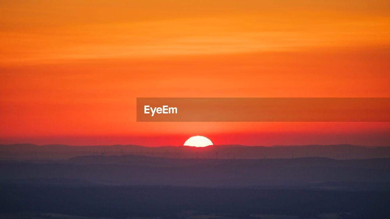 sunset, beauty in nature, scenics - nature, sky, orange color, tranquil scene, sun, tranquility, silhouette, idyllic, mountain, nature, cloud - sky, non-urban scene, no people, environment, outdoors, sunlight, mountain range, majestic, romantic sky