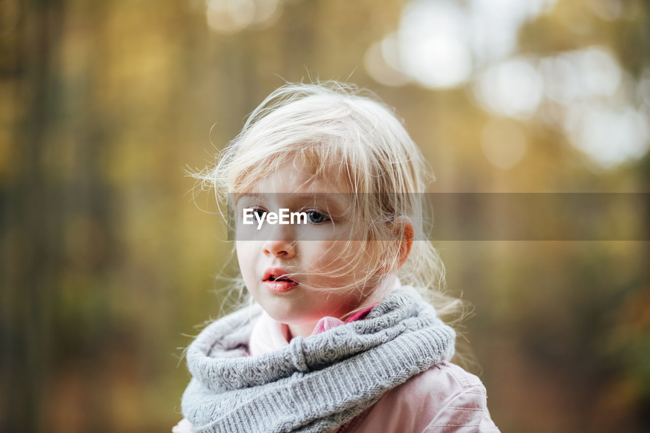 portrait, headshot, focus on foreground, one person, childhood, blond hair, child, hair, looking at camera, real people, lifestyles, close-up, leisure activity, day, warm clothing, women, looking, winter, outdoors, innocence, scarf, hairstyle, beautiful woman, contemplation