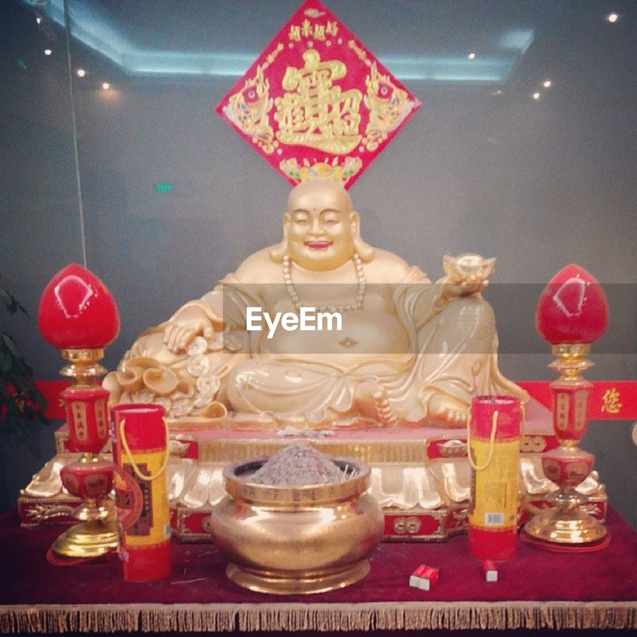 indoors, human representation, art and craft, art, creativity, still life, sculpture, statue, figurine, animal representation, table, glass - material, variation, no people, close-up, decoration, religion, buddha