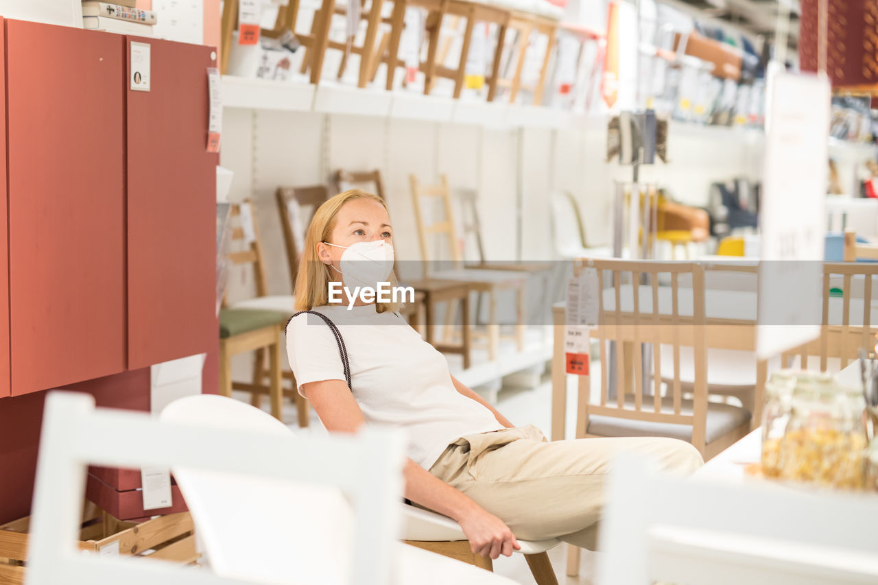Woman sitting on chair in cafe