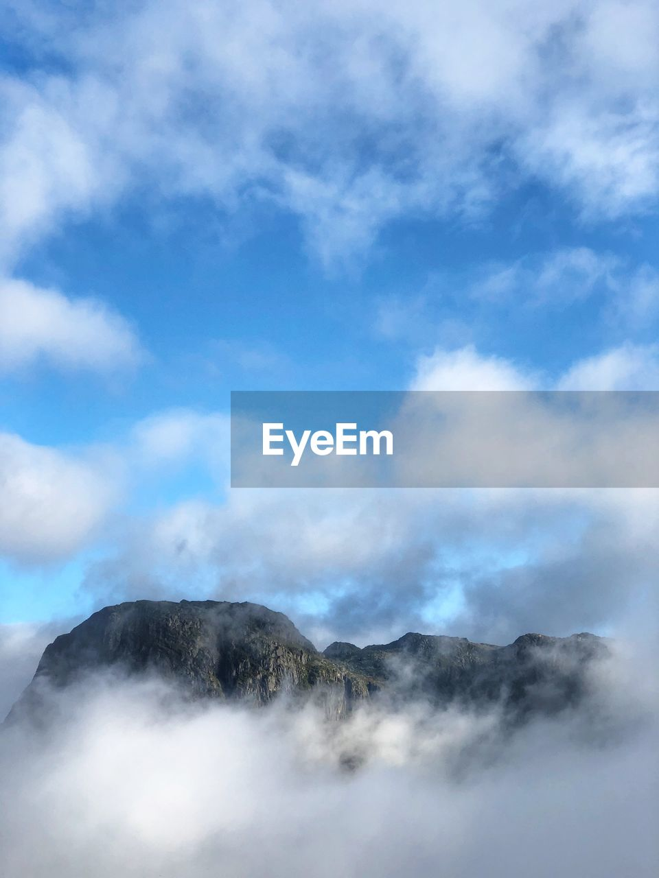 cloud - sky, sky, scenics - nature, beauty in nature, mountain, smoke - physical structure, nature, day, no people, tranquility, tranquil scene, non-urban scene, geology, volcano, outdoors, low angle view, steam, heat - temperature, physical geography, tourism, power in nature, hot spring, volcanic crater