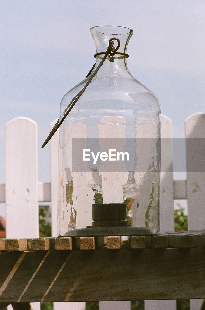 Close-Up Of Old-Fashioned Glass Lantern On Table