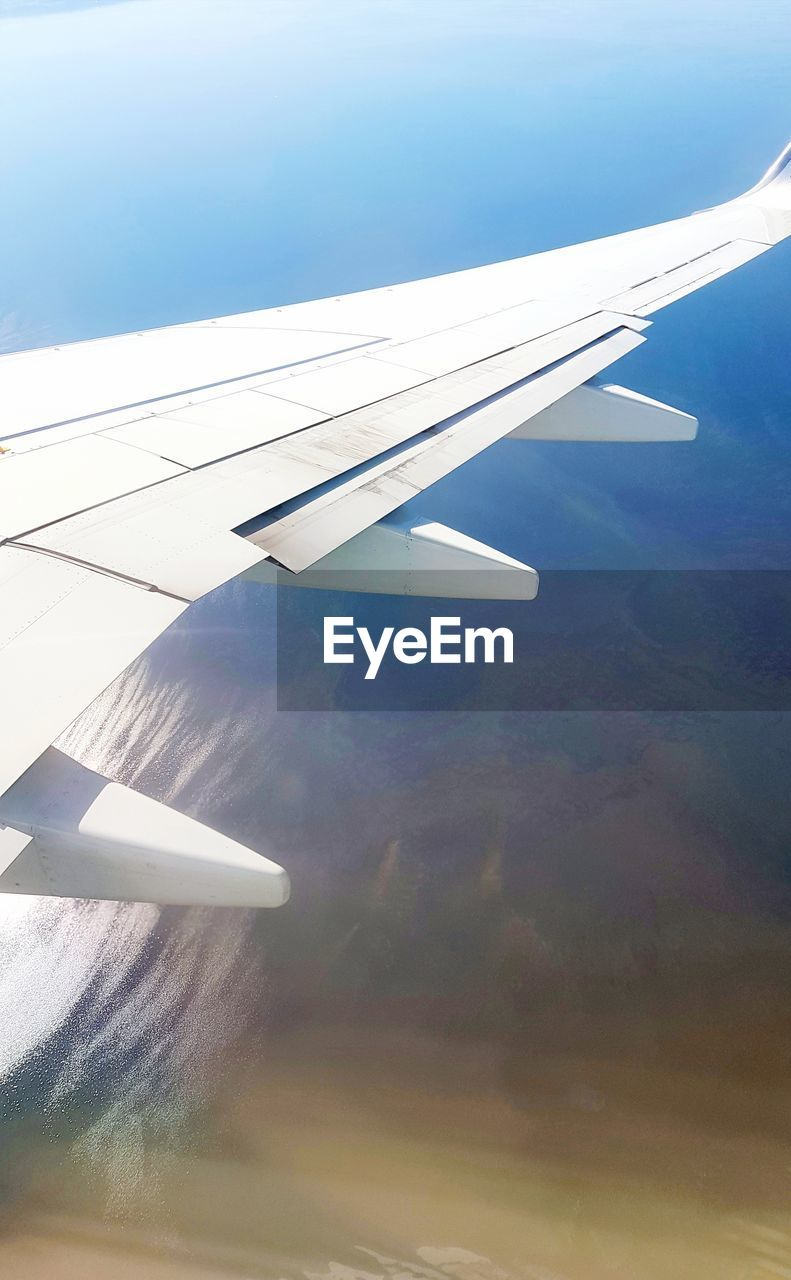 airplane, aerial view, journey, transportation, airplane wing, nature, flying, air vehicle, mode of transport, aircraft wing, no people, day, mid-air, landscape, sky, outdoors, beauty in nature, scenics