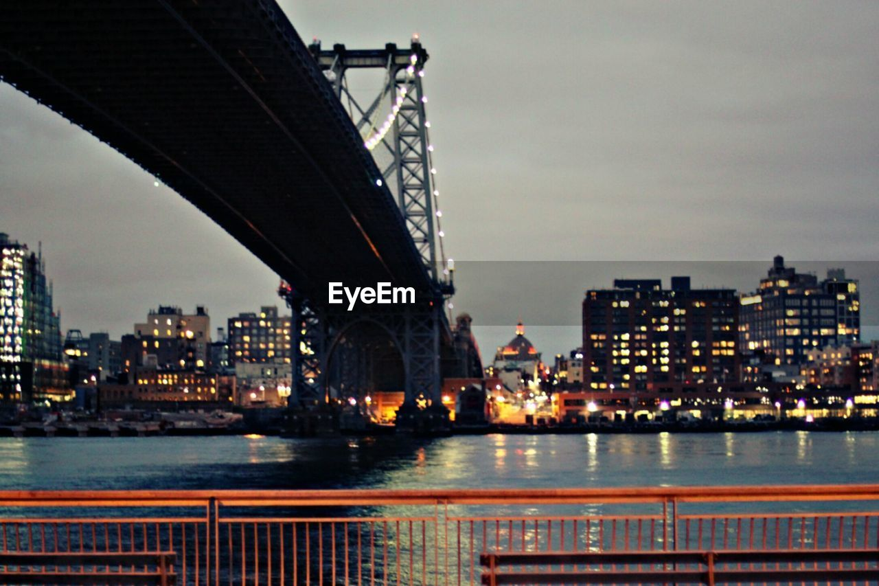 architecture, built structure, city, building exterior, skyscraper, water, river, illuminated, waterfront, cityscape, sky, bridge - man made structure, outdoors, no people, city life, travel destinations, night, urban skyline, modern