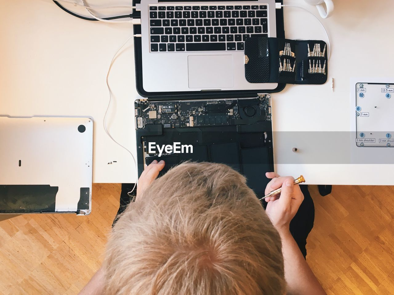 Cropped Image Of Engineer Repairing Laptop At Table