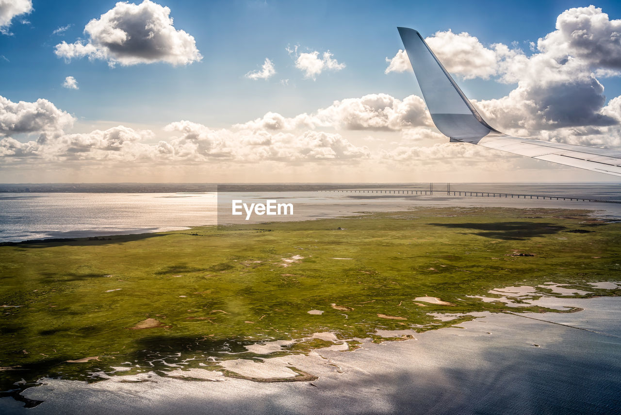 cloud - sky, sky, water, scenics - nature, nature, no people, beauty in nature, tranquil scene, day, tranquility, sea, air vehicle, airplane, transportation, land, beach, horizon, outdoors, environment