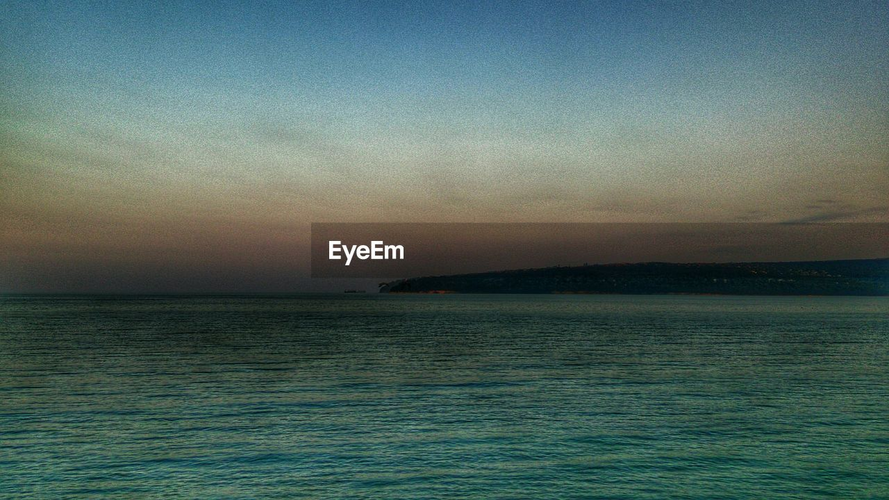 Silhouette Of Coastline At Dusk