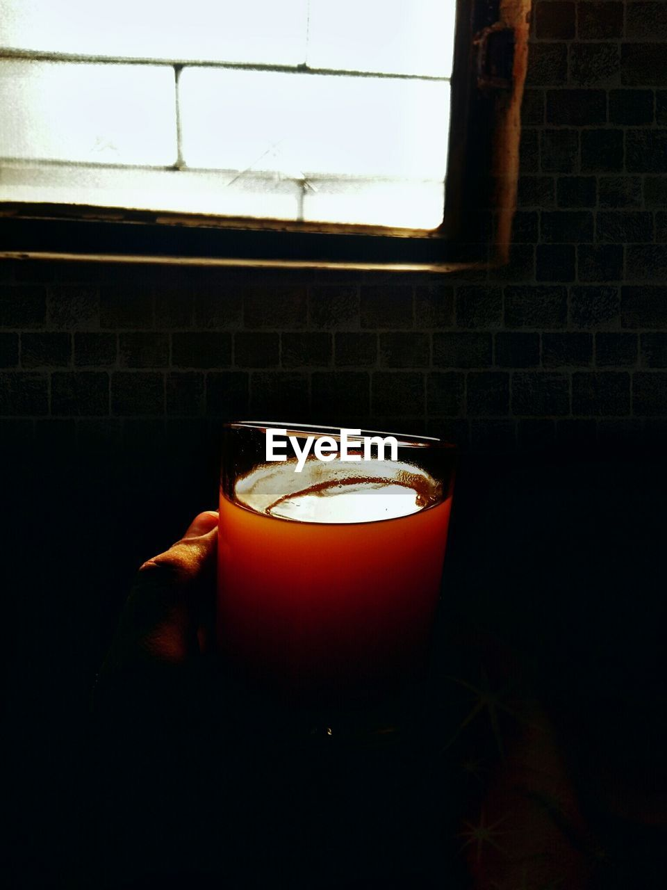 candle, flame, indoors, illuminated, burning, brick wall, window, no people, heat - temperature, close-up, night