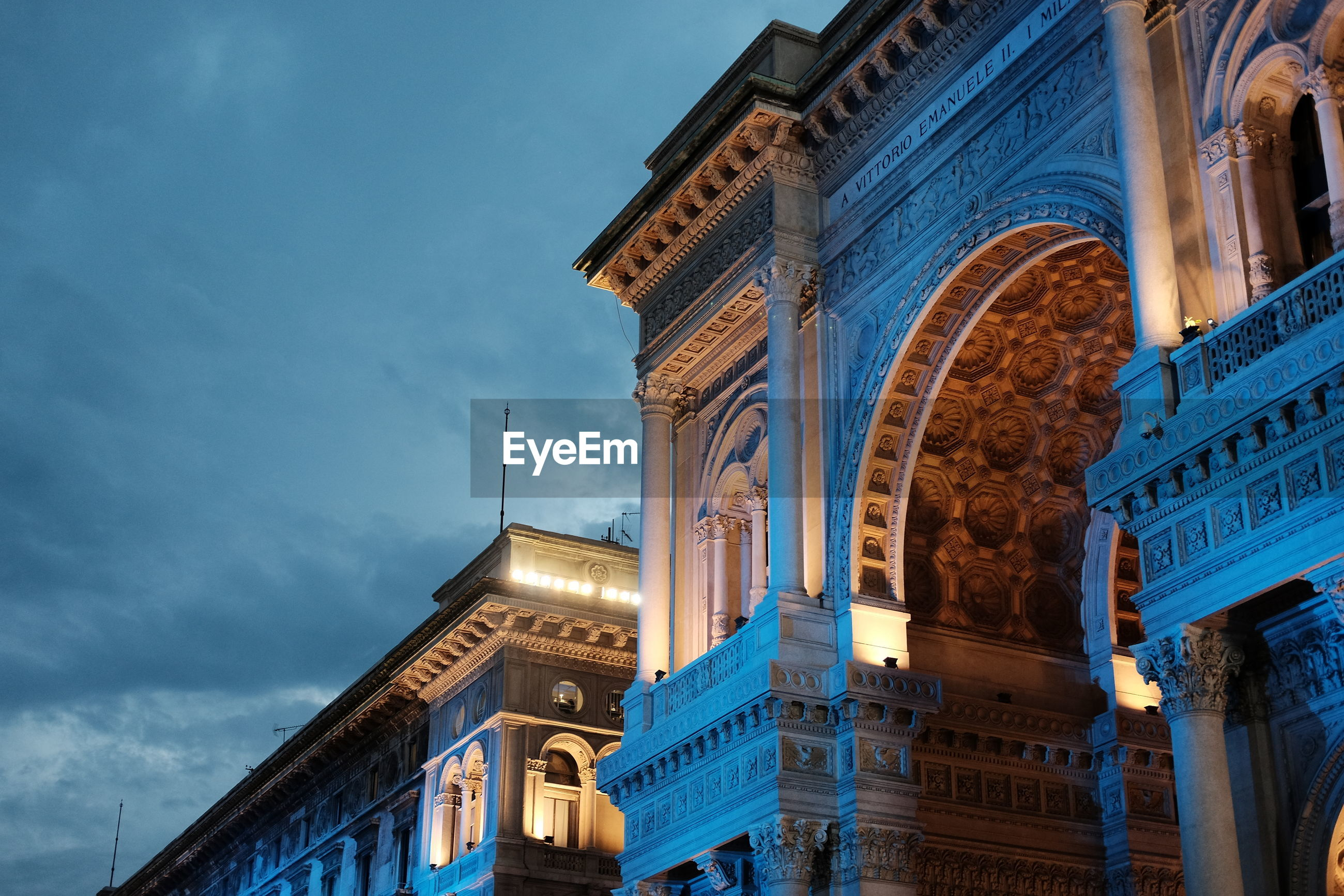 Low angle view of galleria vittorio emanuele ii against sky at dusk