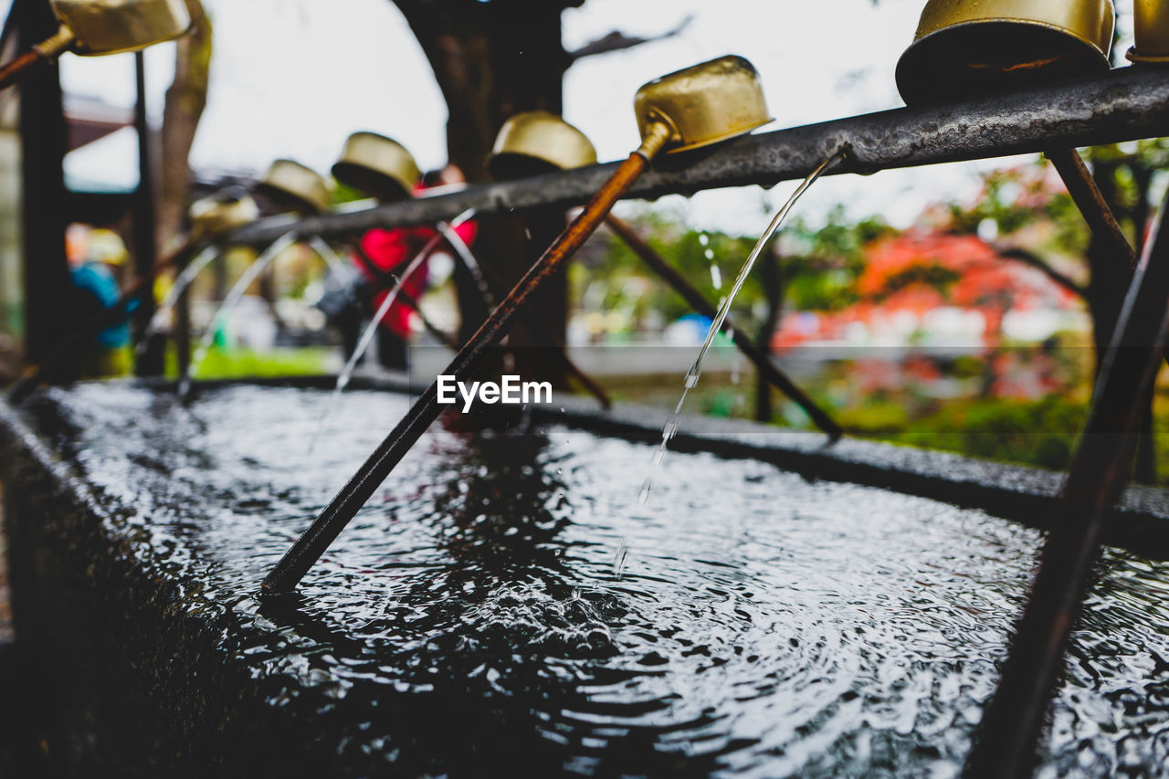 water, metal, no people, close-up, nature, selective focus, focus on foreground, day, safety, security, outdoors, river, protection, wet, flowing water, nautical vessel, boundary, drop, fence, flowing