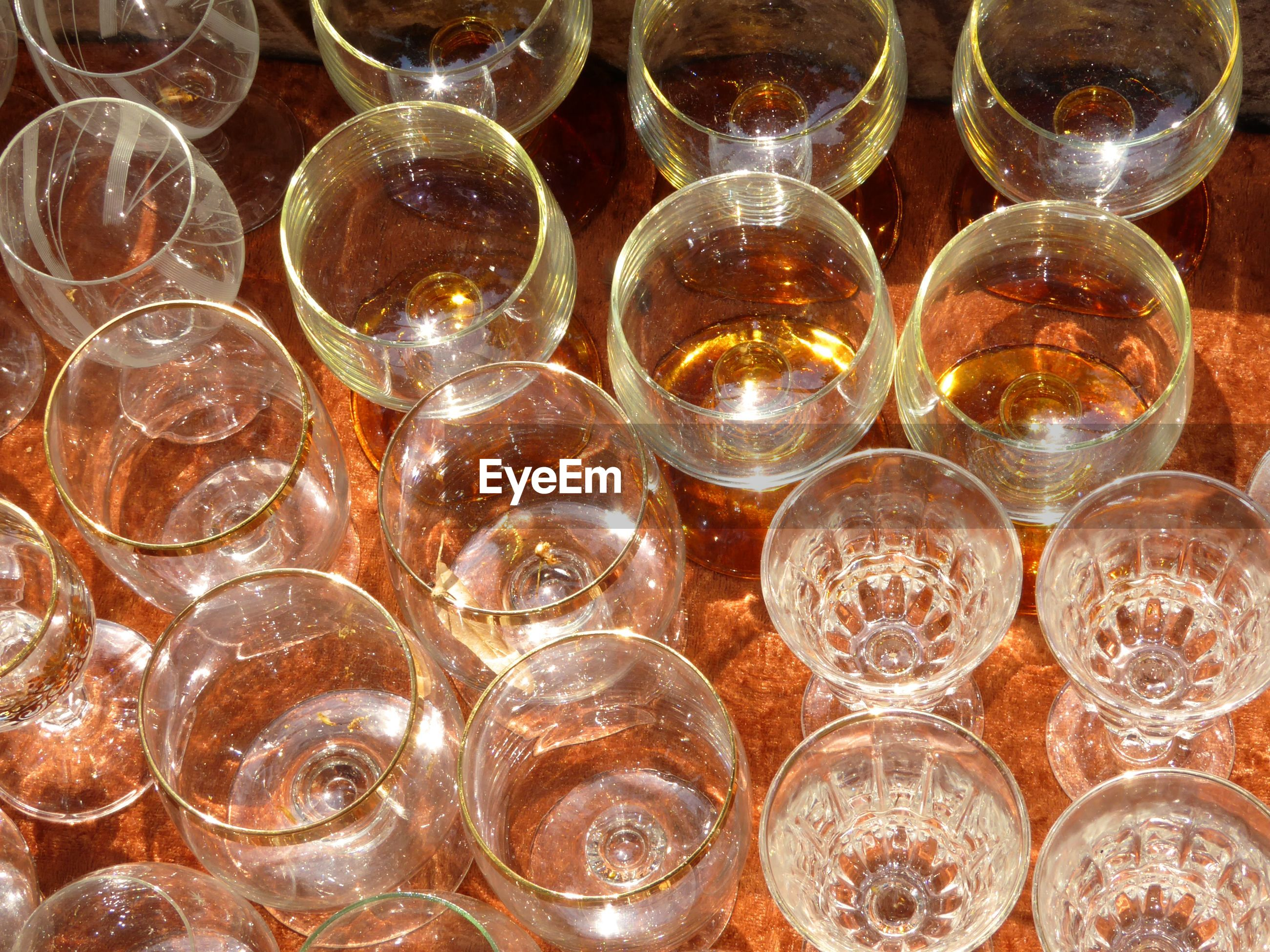 High angle view of glasses arranged on table