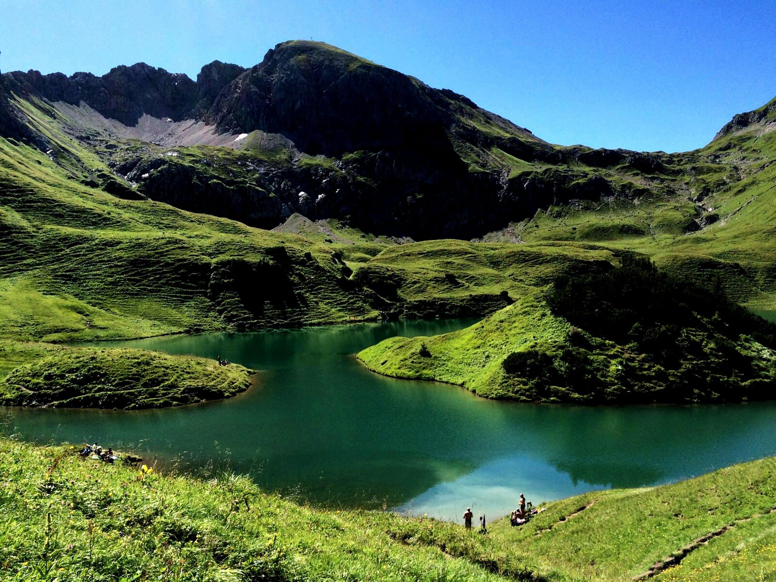 Scenic view of lake against allgau alps
