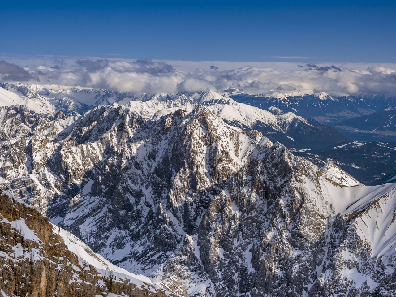 mountain, cold temperature, scenics - nature, snow, beauty in nature, winter, sky, environment, mountain range, tranquil scene, snowcapped mountain, landscape, nature, tranquility, day, no people, non-urban scene, idyllic, white color, outdoors, mountain peak, formation