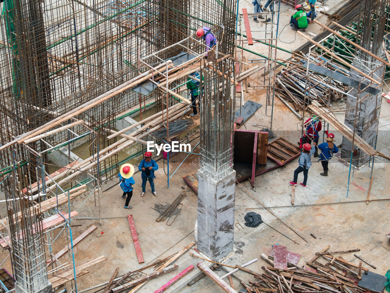 men, group of people, high angle view, architecture, real people, construction site, occupation, working, construction industry, industry, built structure, development, people, incomplete, construction worker, building exterior, group, day, medium group of people, coworker, outdoors