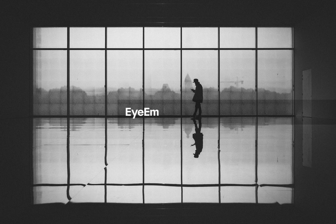 Man Against Glass Window At Centre Pompidou-Metz