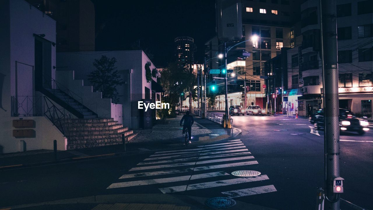 Empty Narrow Road Along Buildings At Night