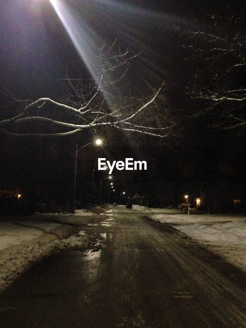 night, illuminated, tree, street light, street, the way forward, outdoors, road, winter, cold temperature, snow, no people, nature, bare tree, sky, city
