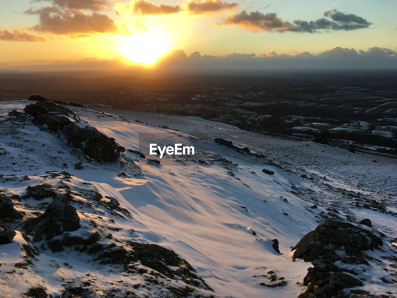 sunset, winter, snow, scenics - nature, sky, beauty in nature, cold temperature, tranquil scene, tranquility, nature, cloud - sky, sun, orange color, sunlight, no people, non-urban scene, water, covering, land, outdoors, snowcapped mountain