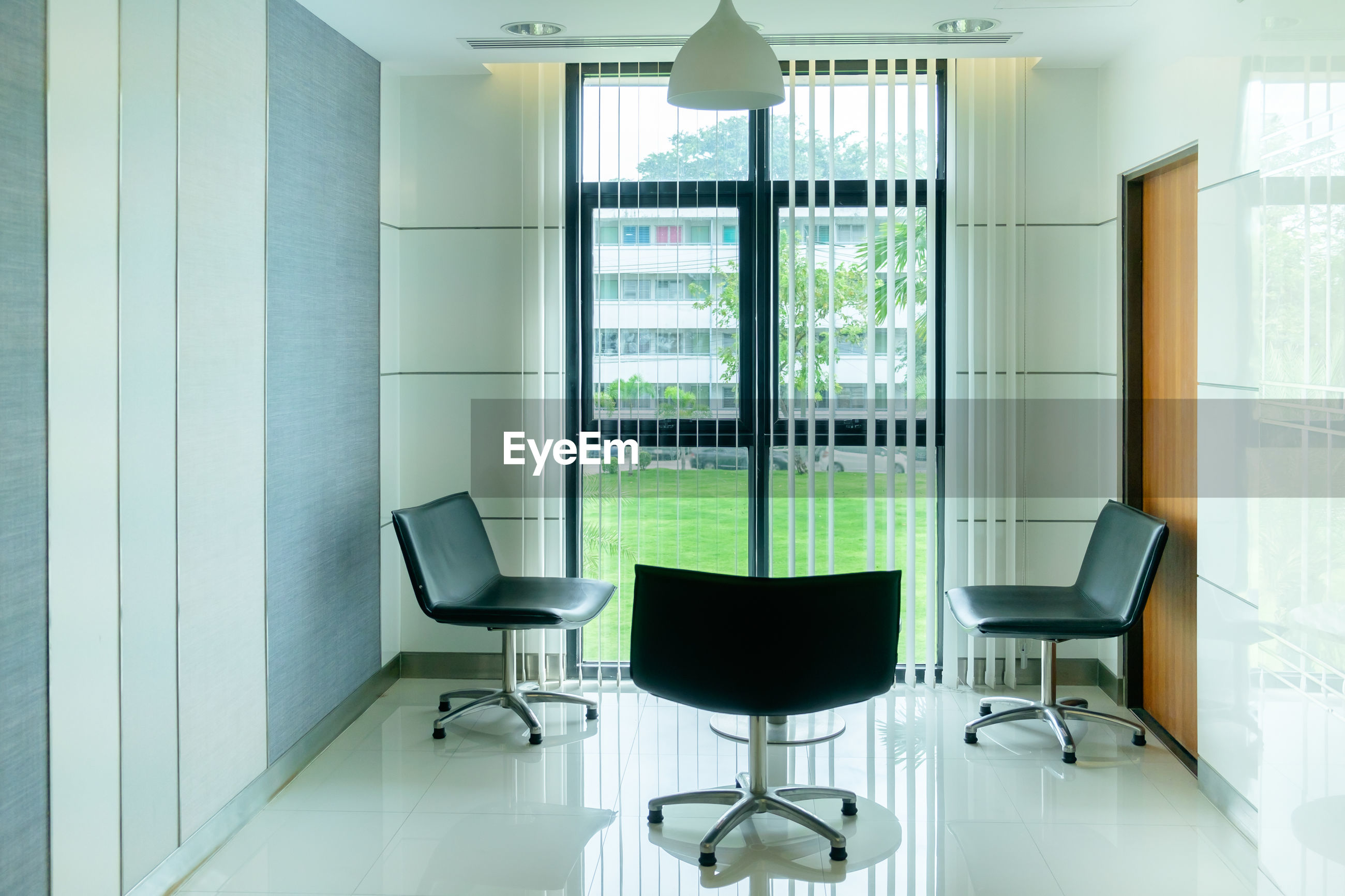 Chairs by window in office