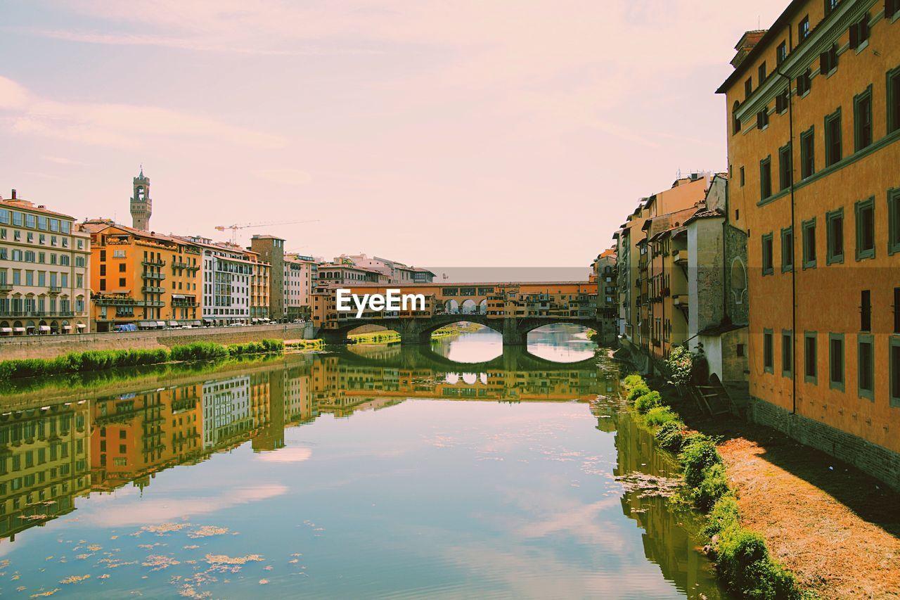 Ponte Vecchio Over Arno River Against Sky