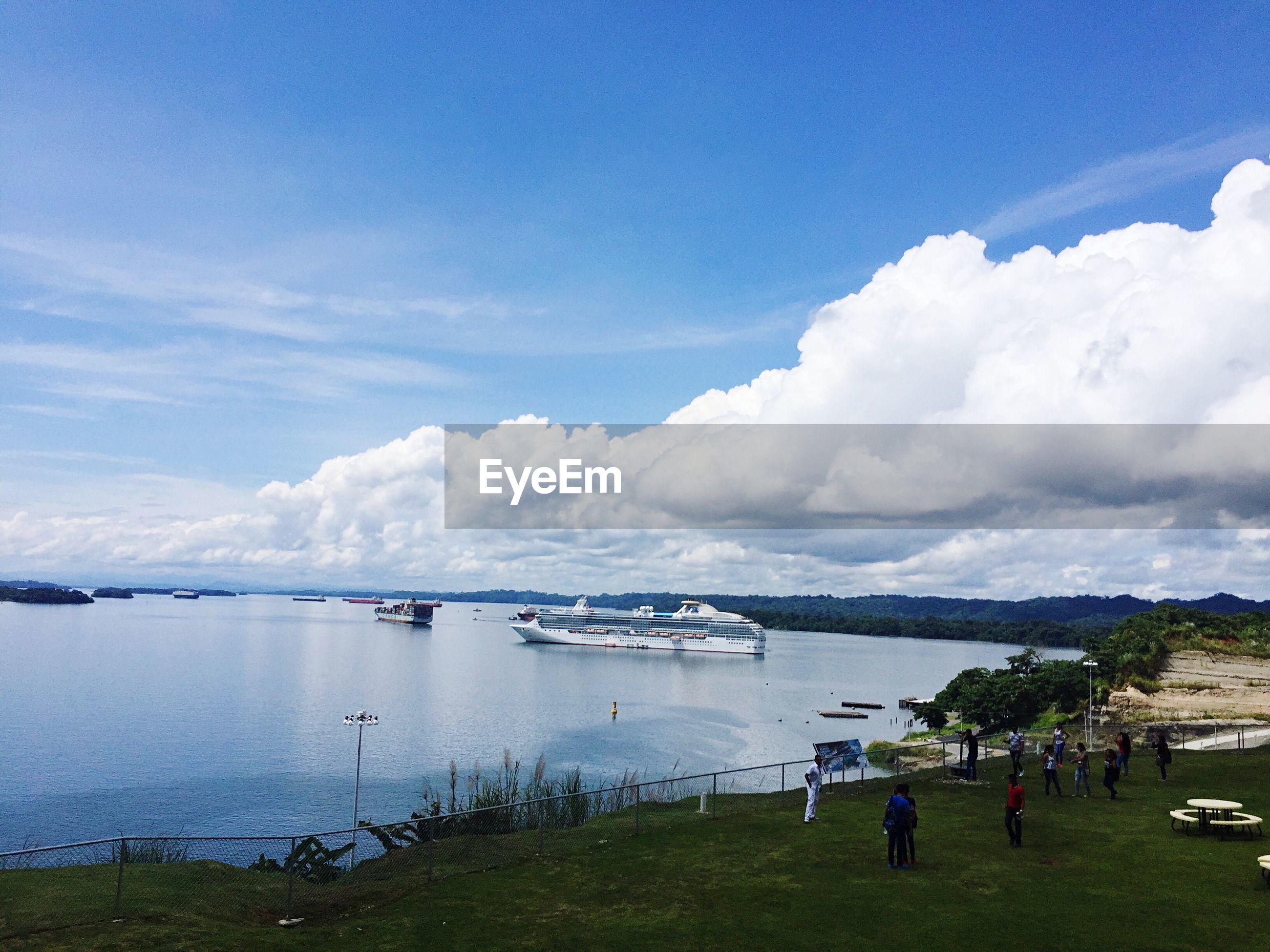 cloud - sky, sky, water, blue, nature, nautical vessel, sea, scenics, beauty in nature, travel destinations, outdoors, vacations, tranquility, tranquil scene, landscape, harbor, day, extreme weather, no people, yacht