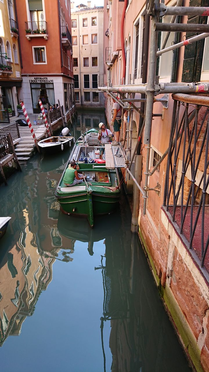 nautical vessel, water, mode of transportation, reflection, transportation, built structure, architecture, moored, building exterior, canal, waterfront, day, no people, nature, building, travel, residential district, outdoors, harbor