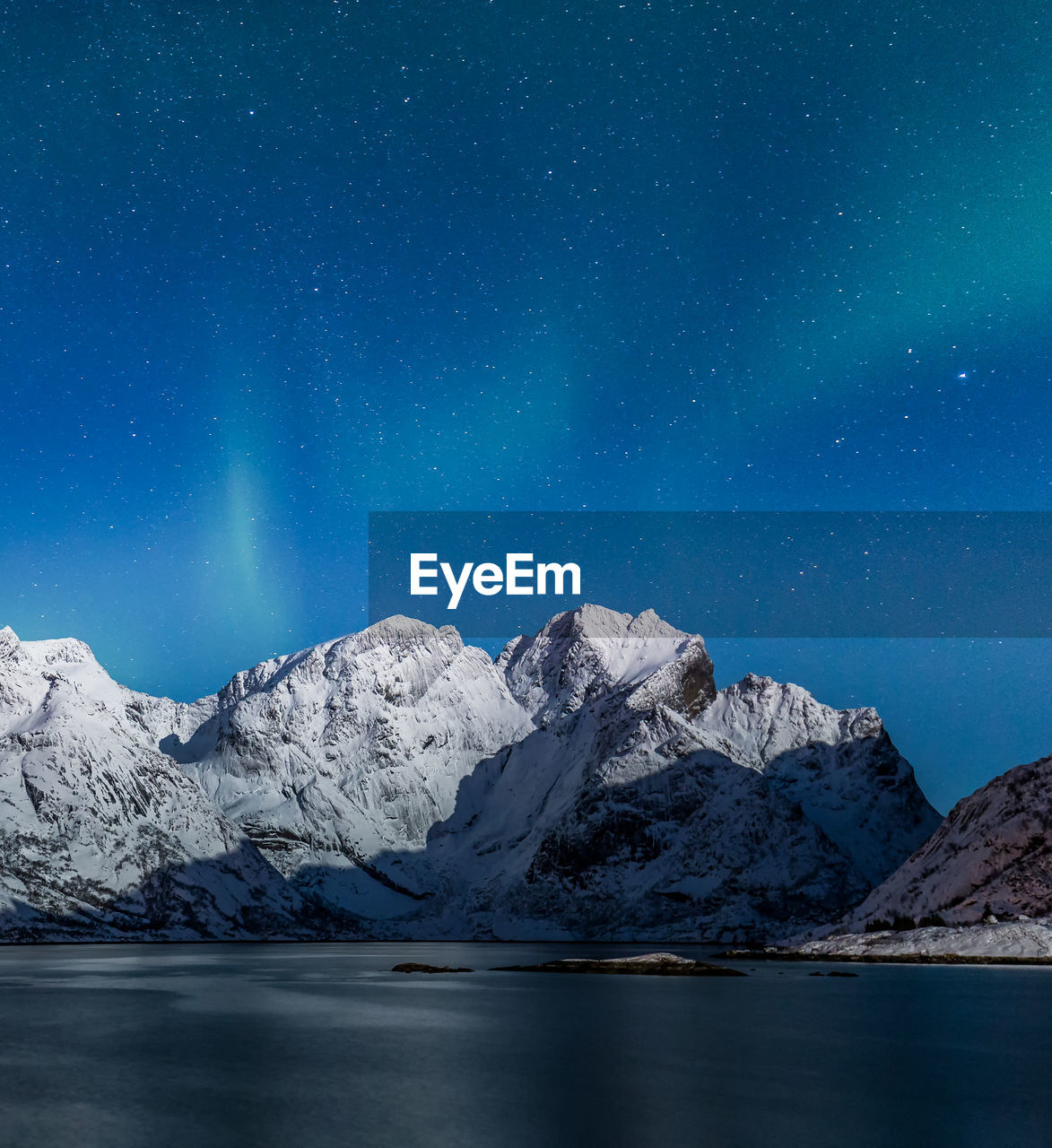Scenic View Of Snowcapped Mountains Against Sky At Night