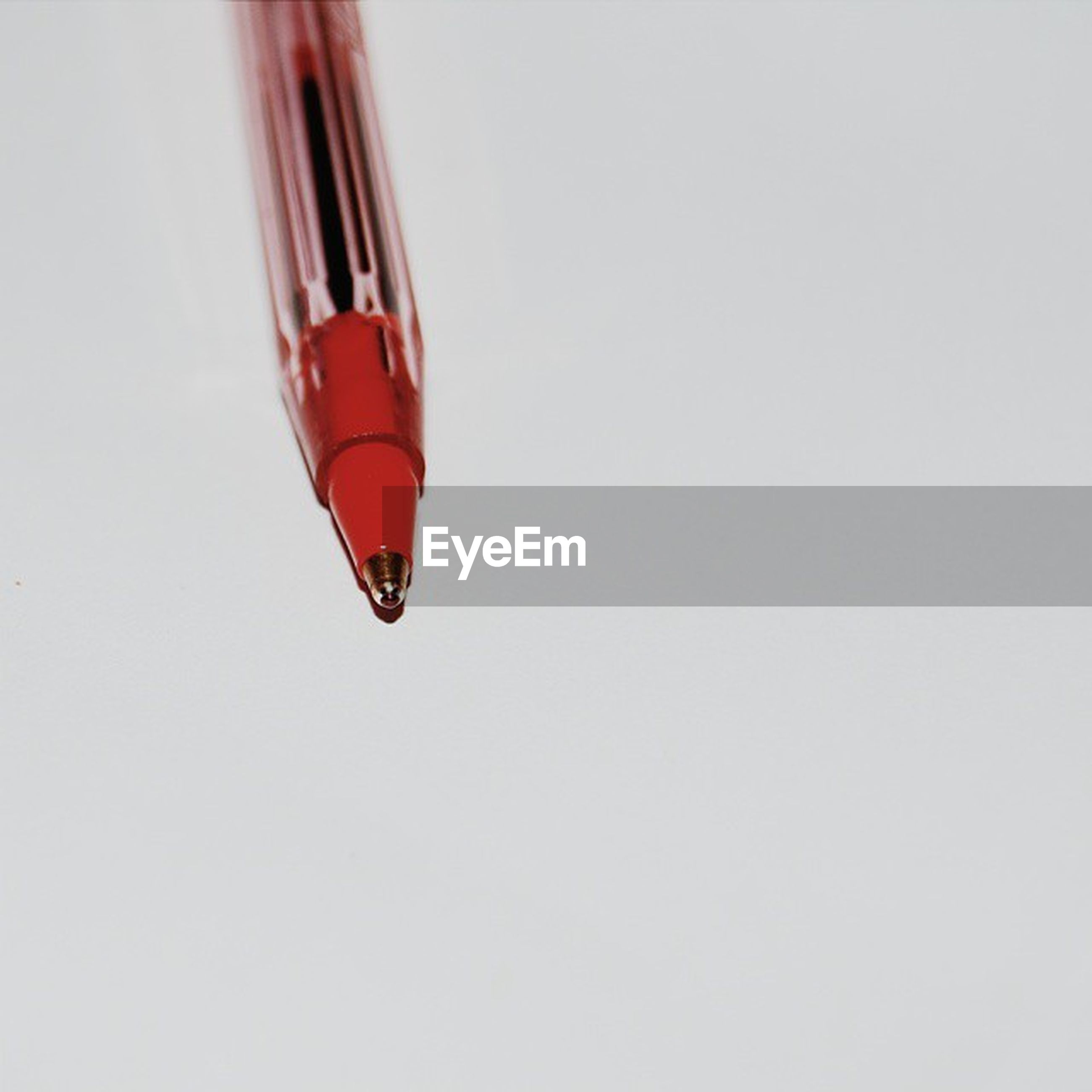 copy space, red, studio shot, white background, still life, clear sky, close-up, no people, single object, low angle view, simplicity, multi colored, day, part of, two objects, outdoors, cut out, three objects, glass - material