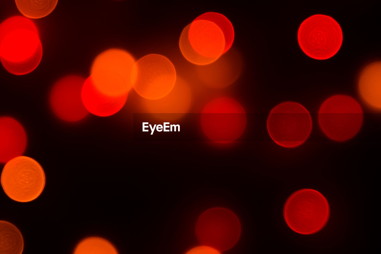 illuminated, night, defocused, glowing, lighting equipment, pattern, backgrounds, no people, abstract, light, light - natural phenomenon, circle, geometric shape, shape, red, electric light, full frame, orange color, decoration, multi colored, lens flare, black background, abstract backgrounds