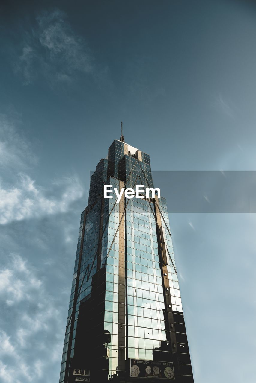 built structure, architecture, sky, building exterior, low angle view, building, cloud - sky, tower, tall - high, city, nature, day, office building exterior, no people, skyscraper, travel destinations, sunlight, modern, religion, spire, outdoors