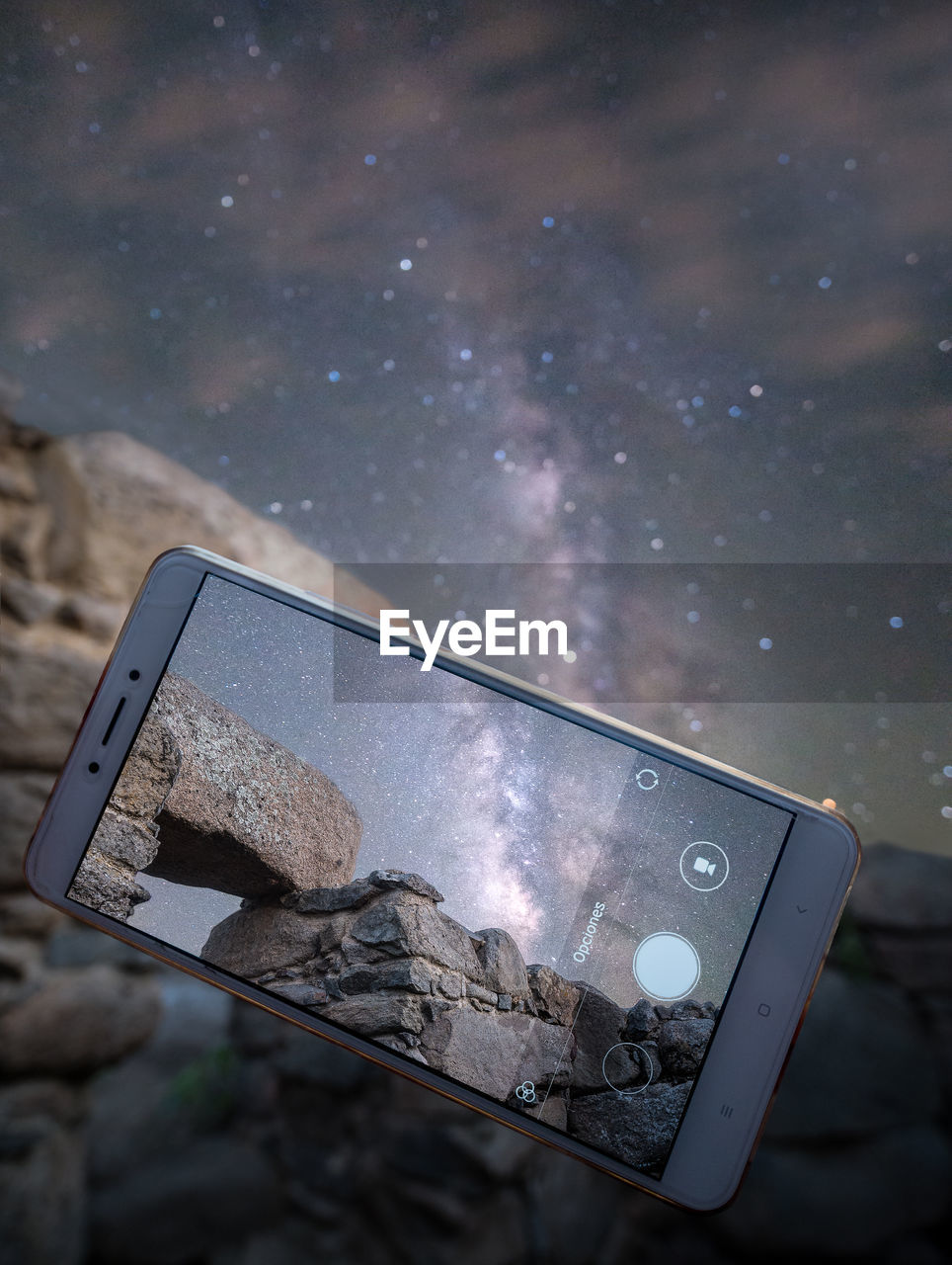 CLOSE-UP OF SMART PHONE AGAINST SKY
