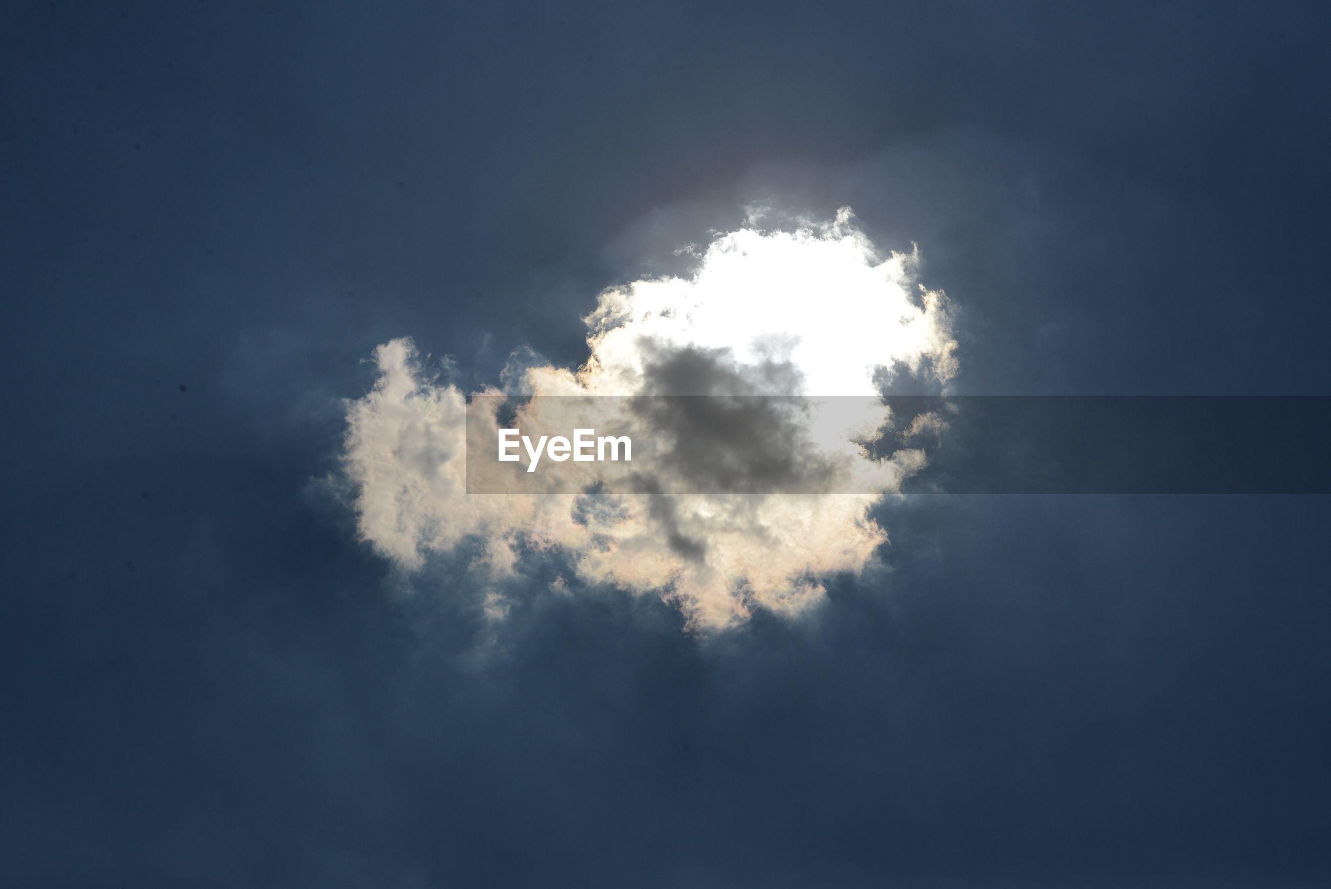 Back lit cloud in blue sky