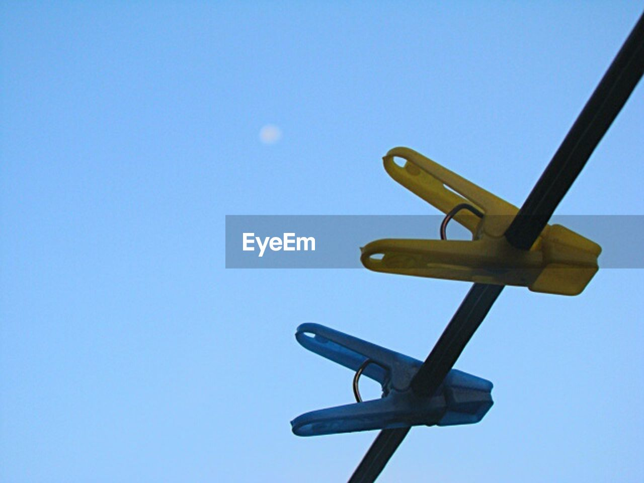clear sky, blue, no people, low angle view, sky, day, airplane, model airplane, outdoors, close-up