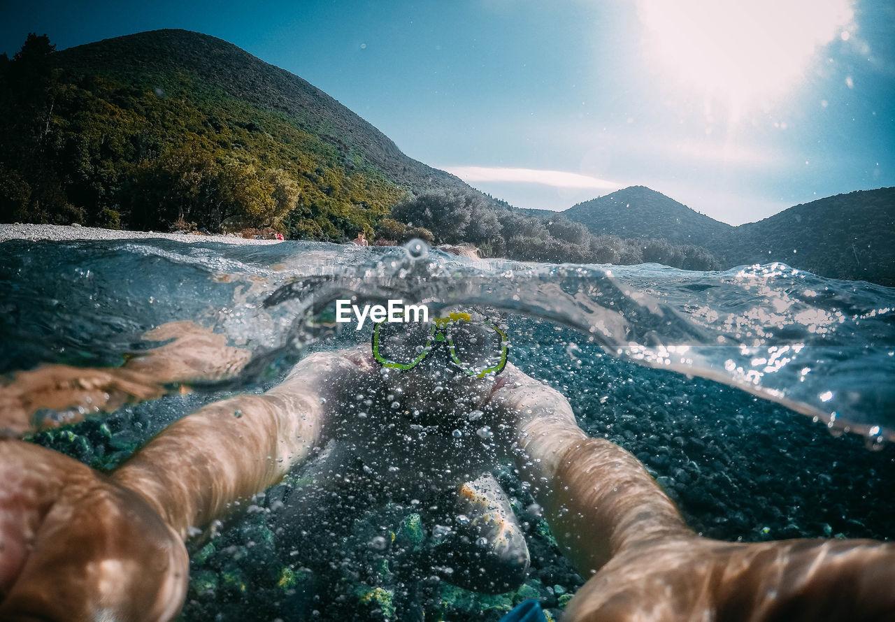 Close-Up Of Man Swimming In Lake