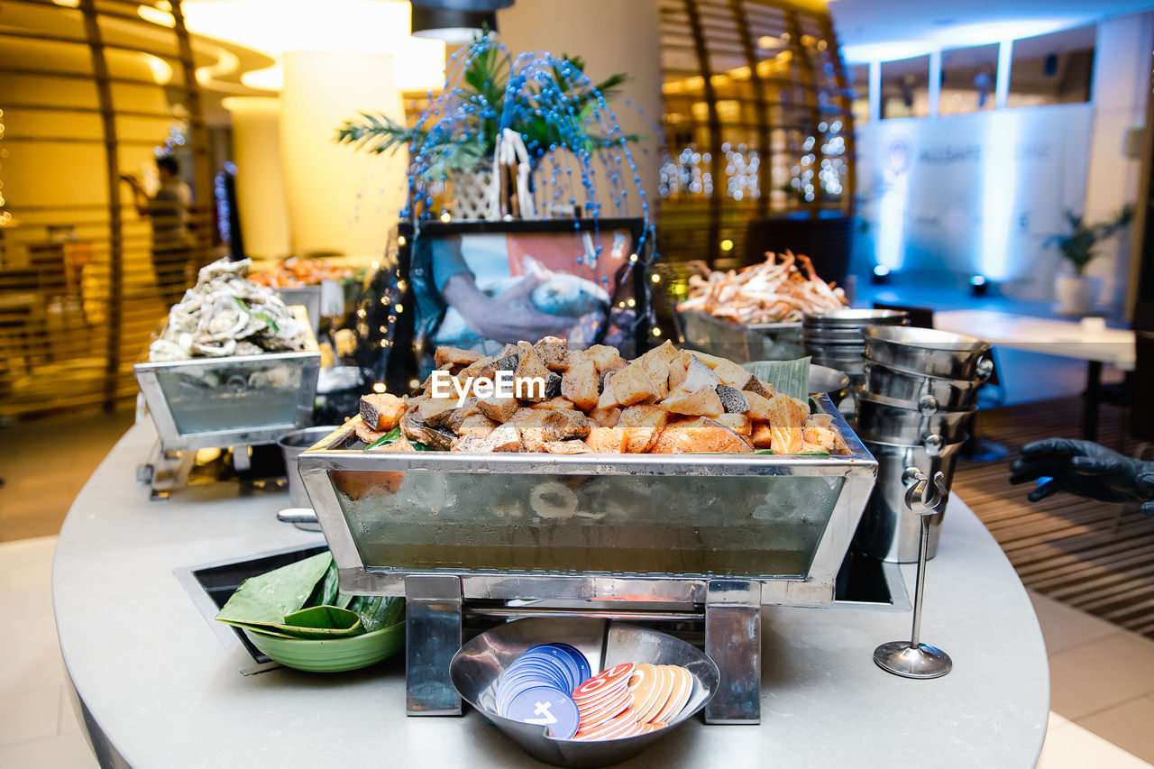 CLOSE-UP OF FOOD FOR SALE IN RESTAURANT