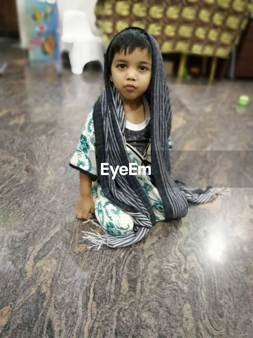 one person, real people, sitting, child, childhood, casual clothing, portrait, looking at camera, lifestyles, front view, leisure activity, girls, full length, indoors, hair, cute, looking, innocence, hairstyle, contemplation