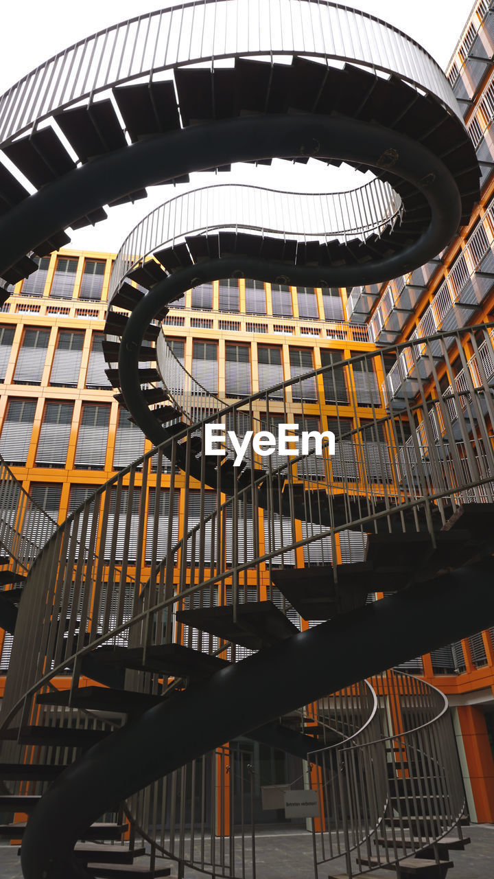 architecture, staircase, steps and staircases, built structure, railing, low angle view, no people, metal, spiral, pattern, arts culture and entertainment, day, indoors, modern, spiral staircase, nature, building, musical equipment, wrought iron