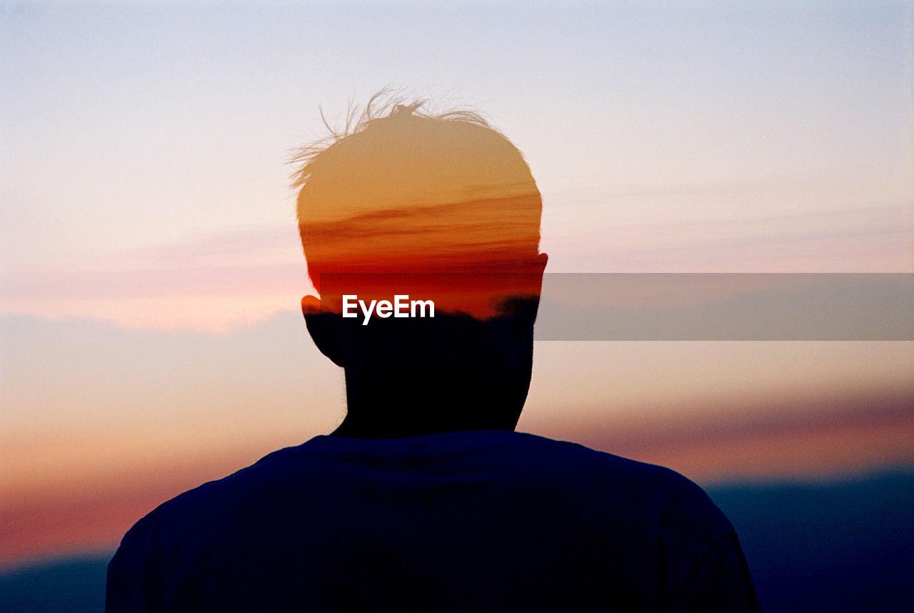 Multiple Exposure Of Man And Orange Sky