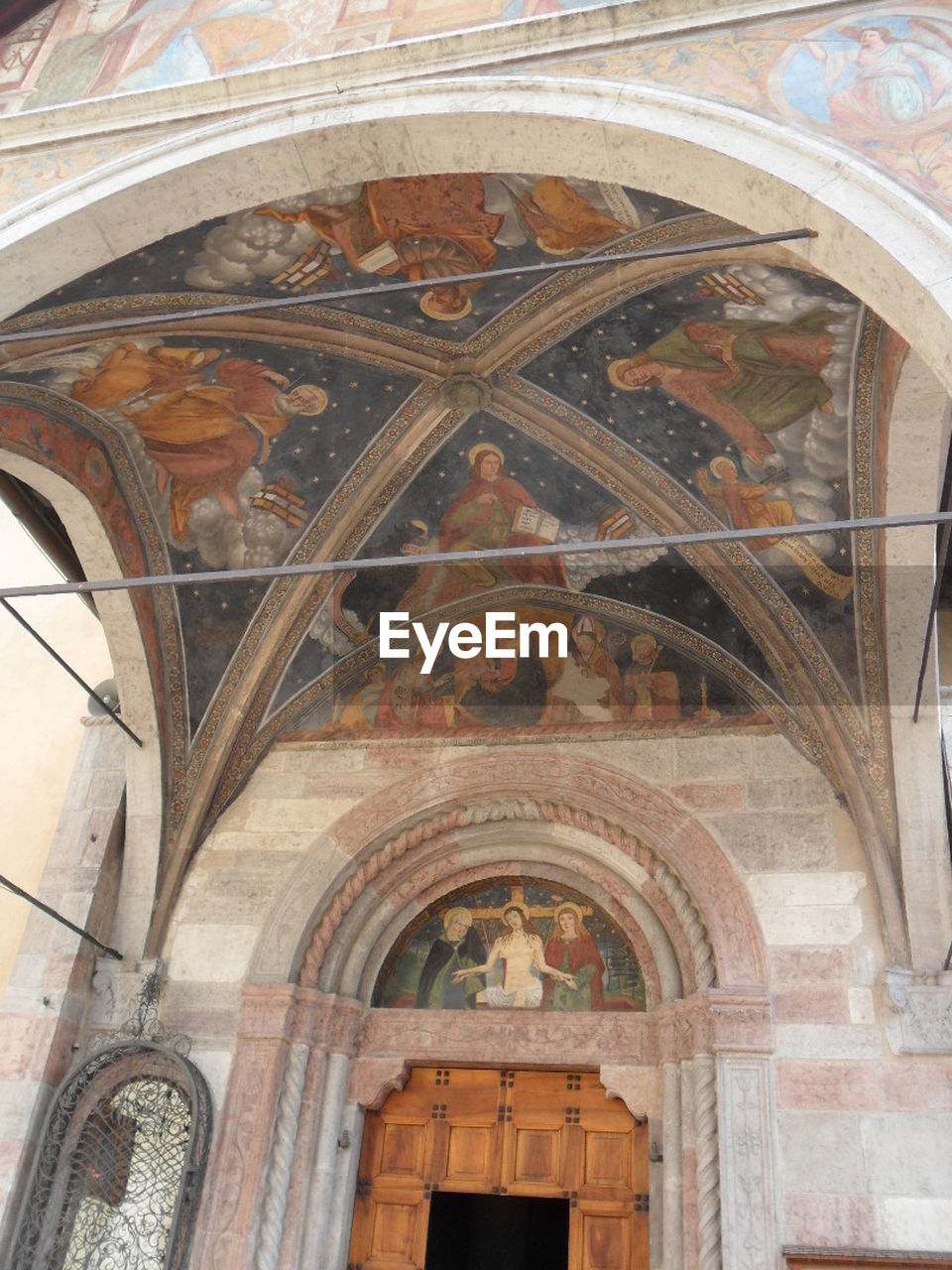 religion, architecture, place of worship, arch, fresco, history, spirituality, low angle view, built structure, no people, day, indoors