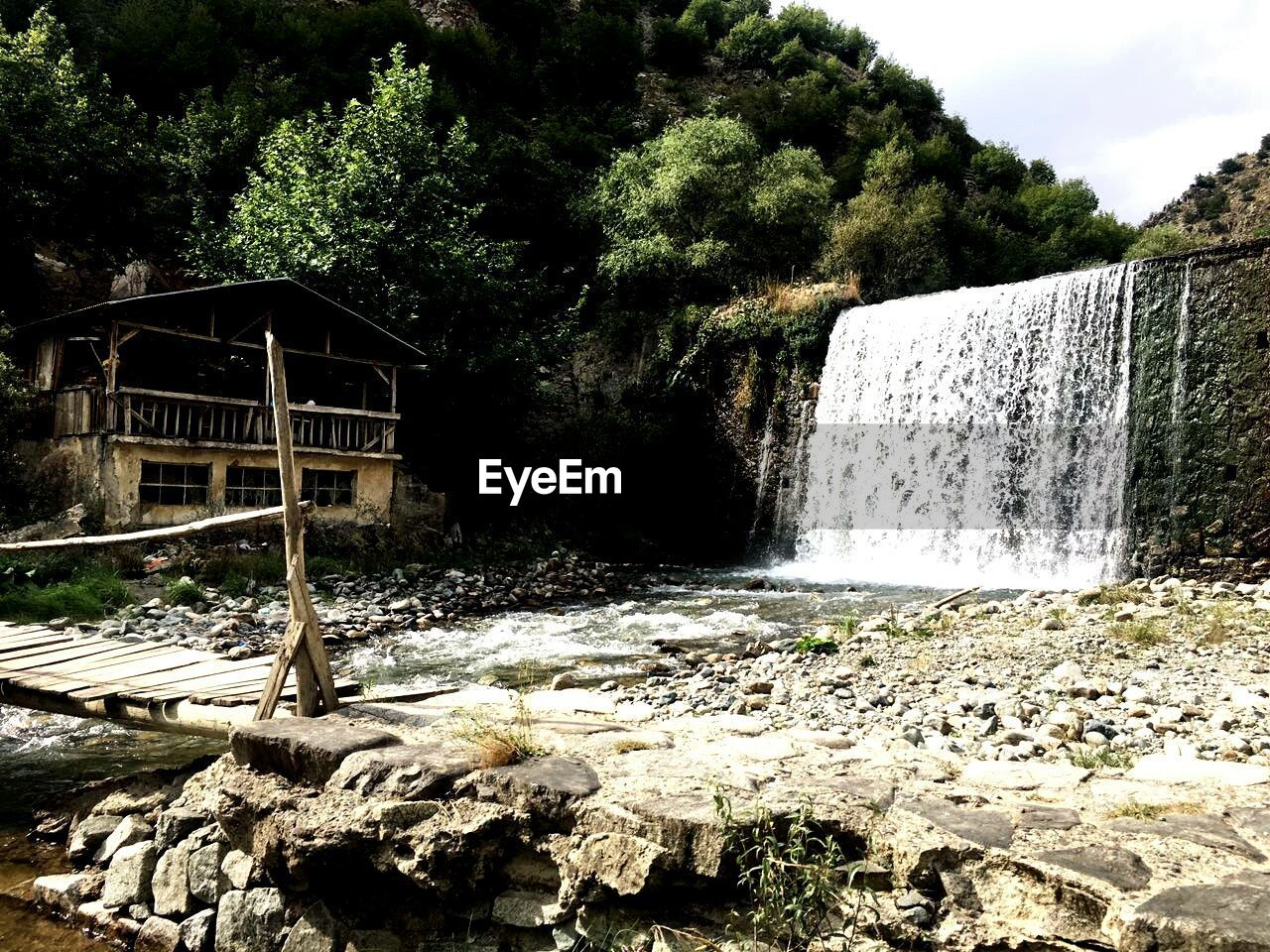 water, waterfall, rock - object, motion, tree, day, nature, no people, outdoors, built structure, long exposure, forest, architecture, beauty in nature, scenics, sky