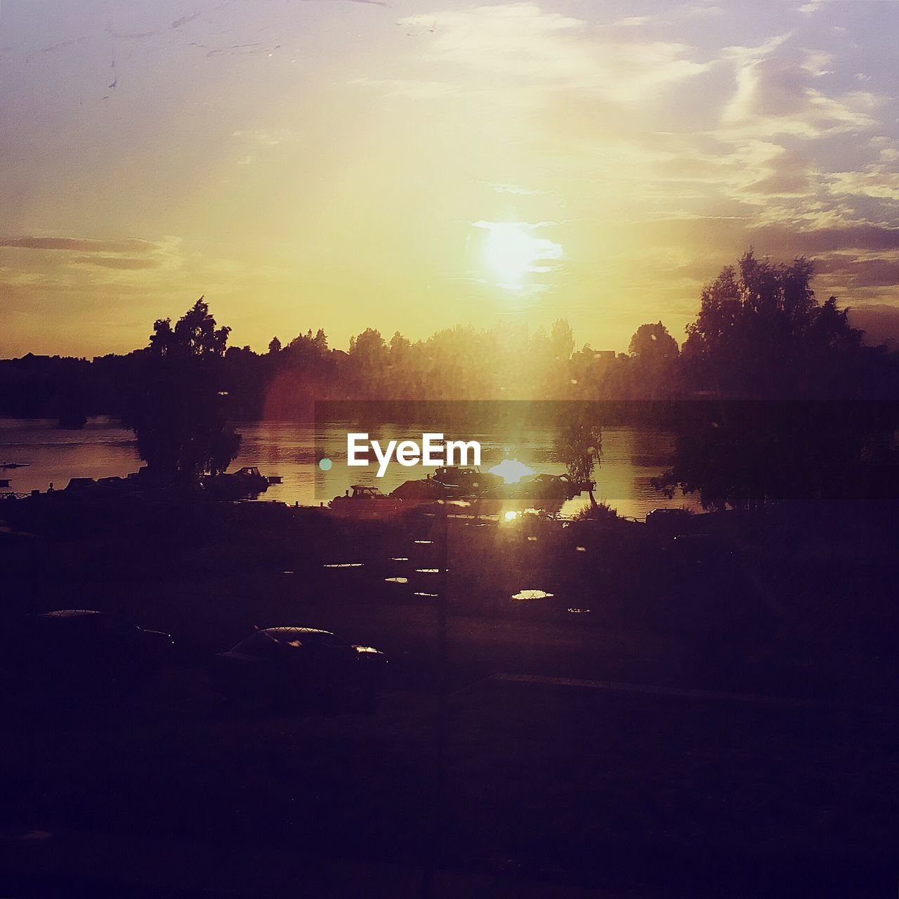 sunset, silhouette, sun, sky, tree, nature, sunlight, no people, water, outdoors, beauty in nature
