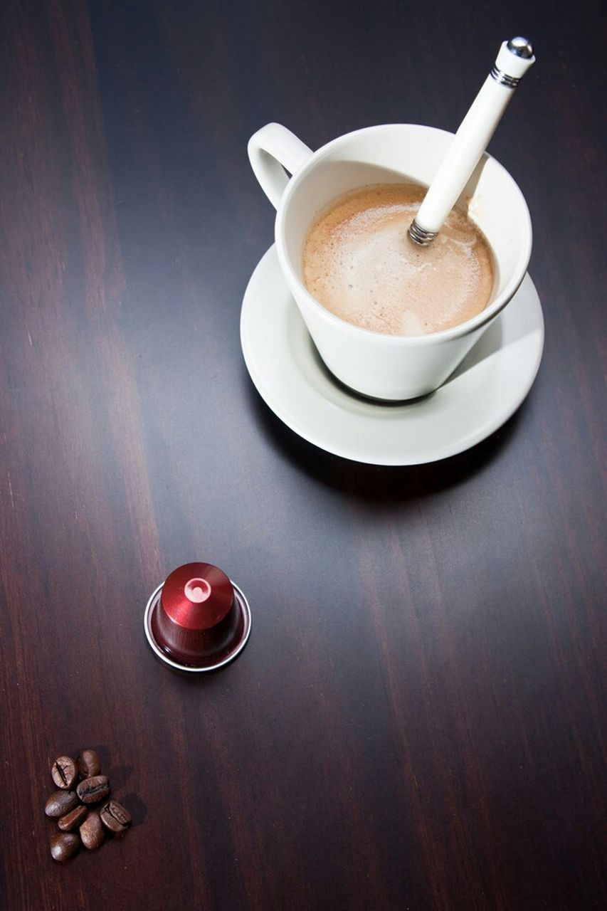 drink, food and drink, refreshment, cup, coffee, table, mug, coffee cup, coffee - drink, still life, indoors, high angle view, freshness, no people, food, wood - material, crockery, kitchen utensil, saucer, eating utensil, non-alcoholic beverage