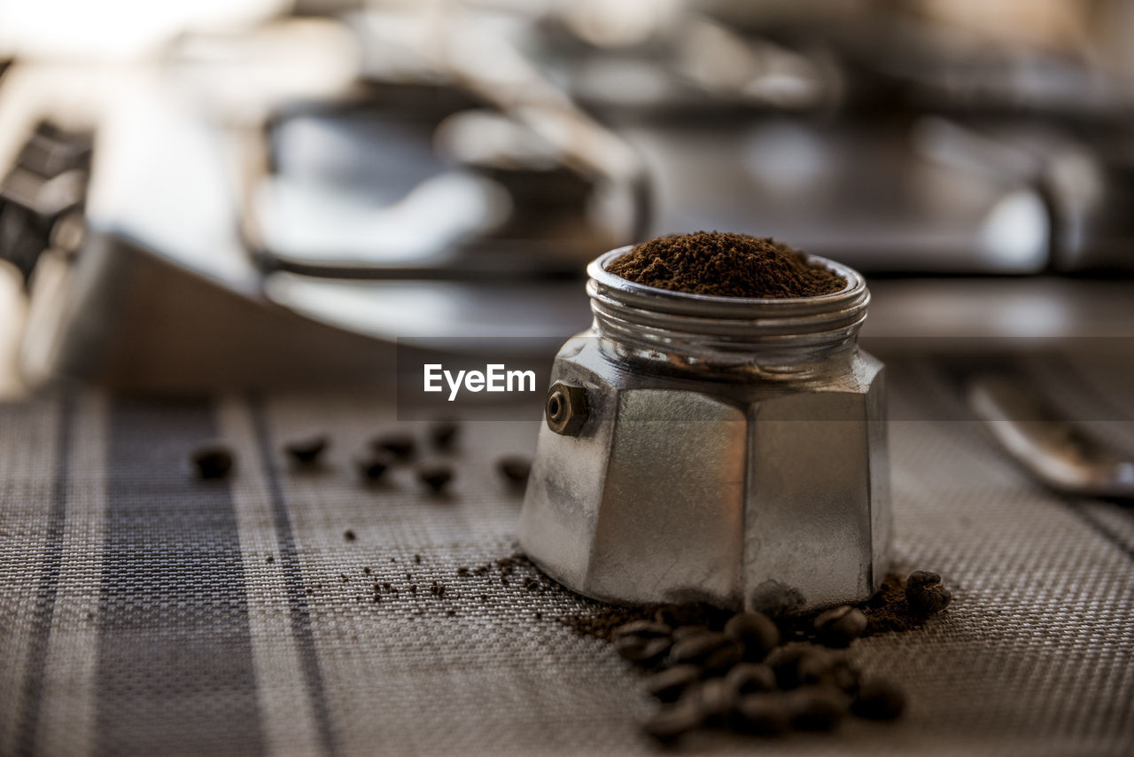 Close-up of coffee in metal container on table