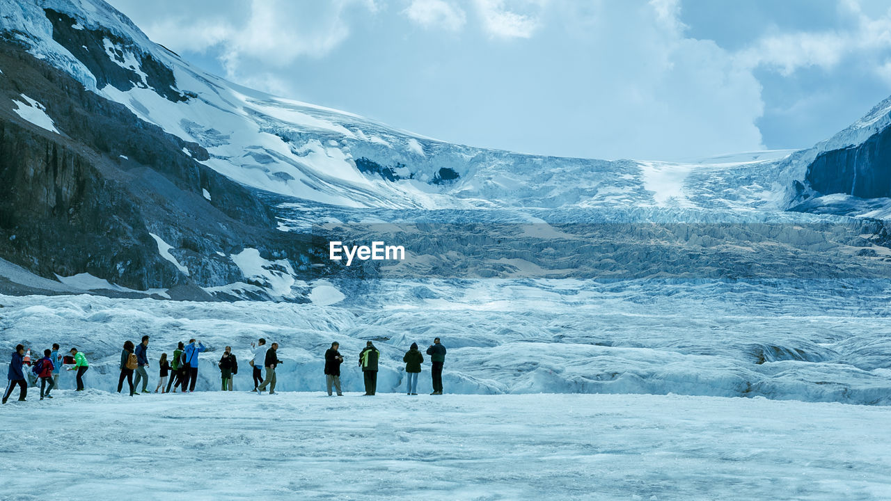 winter, snow, cold temperature, group of people, leisure activity, beauty in nature, mountain, real people, large group of people, sport, scenics - nature, crowd, nature, lifestyles, sky, cloud - sky, day, frozen, mountain range, ice, outdoors, snowcapped mountain