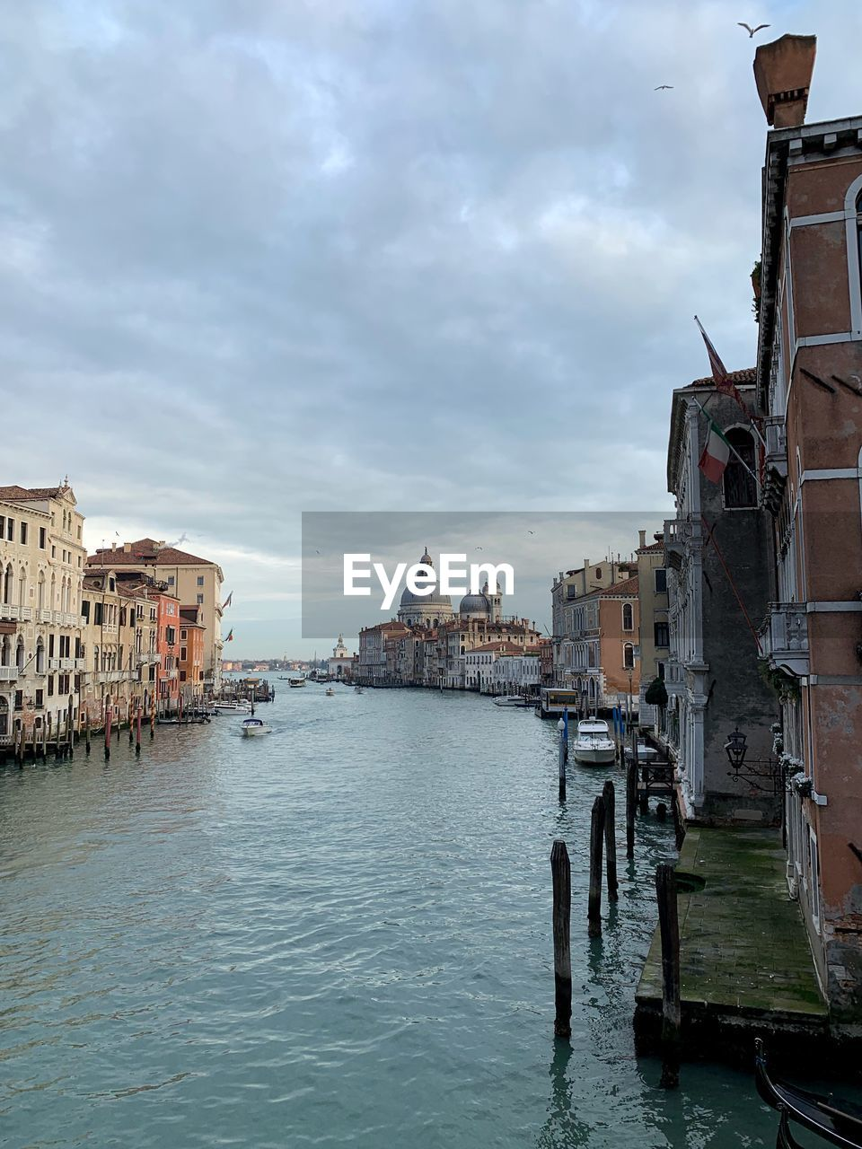 architecture, building exterior, built structure, water, cloud - sky, sky, waterfront, city, nature, nautical vessel, building, canal, transportation, travel destinations, mode of transportation, day, travel, residential district, no people, outdoors, gondola - traditional boat, wooden post